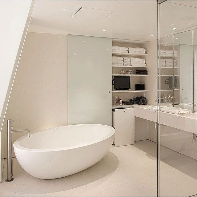 The interior of the bathroom is in high-tech style